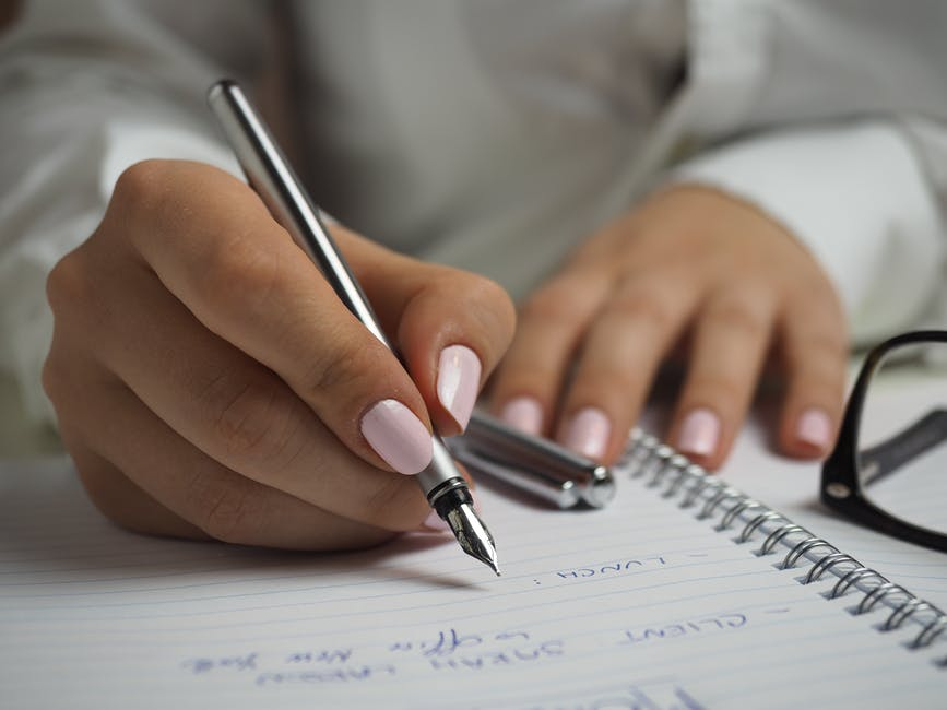 woman writing a list